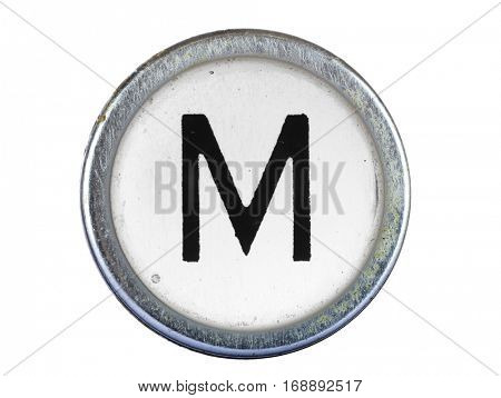 Vintage typewriter letter M isolated on white
