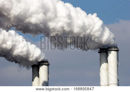 White smoke emission from four factory pipes
