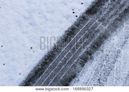 tire track in the snow in the winter