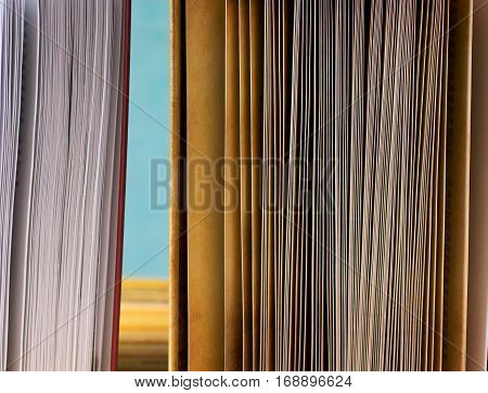 Book on a blue background. Back to school. Copy space. Top view.