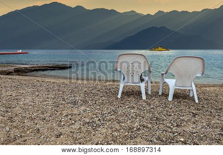 Morning at a public beach of Eilat - number one resort and recreational city in Israel located on the Red Sea