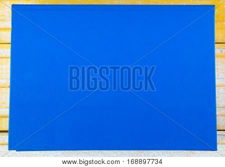 Book on wooden table. Back to school. Copy space. Top view.