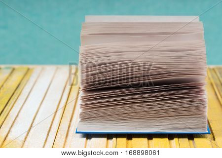 Open book on wooden table. Back to school. Copy space. Top view.