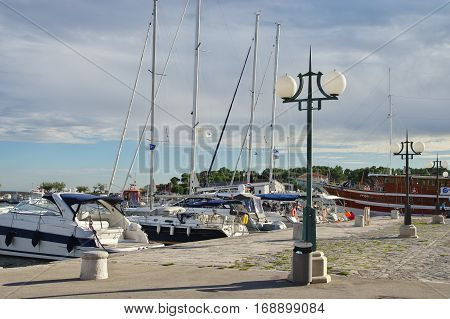 Krk Croatia - September 19 2016: a town in the south of the island of Krk. It is a tourist resort in old town there are preserved fragments of buildings from Roman times. Harbor. On the waterfront moored many boats and yachts.