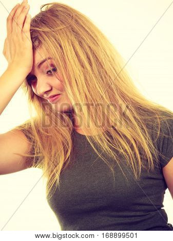 Ashamed Embarrassed Blonde Woman With Hand On Face