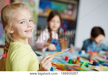 Youngster with paintbrush