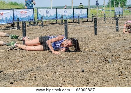 Tyumen, Russia - July 9, 2016: Steel Character extrim race on Voronino Hill. Army Test. People jumping, crawling, passing under a barbed wires or climbing obstacles during extreme obstacle race