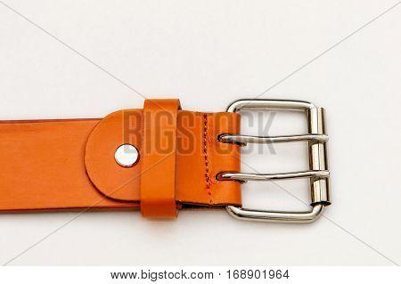 Closeup of an orange belt buckle .