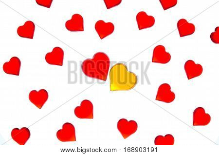 Bright red hearts on a striped background with yellow and red hearts. In order to use Valentine's Day, weddings, International Women's Day