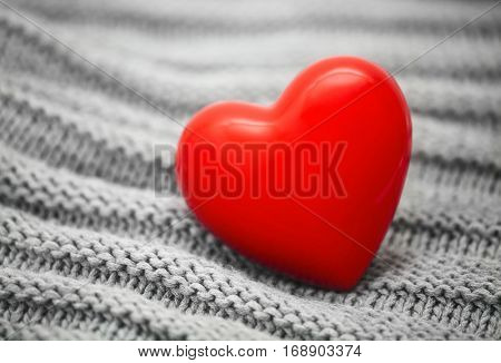 Red heart on knitted wool background