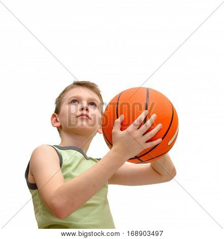 Little boy 9 years old With Basketball isolated on white. Kid prepares to throw the ball