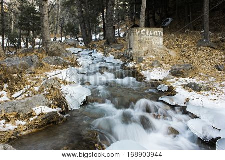 Waterflow in the woods during snow fall in naran valley kpk Pakistan