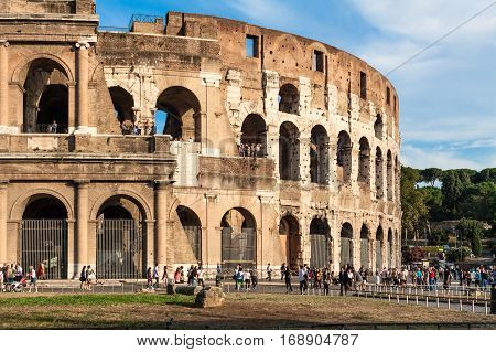 ROMEITALY- September 17 2010: Tourists visit the famous ancient Colosseum of Rome in a sunny summer day.