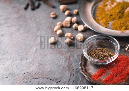 Cardamom chilli cumin curry on slate partial blur horizontal