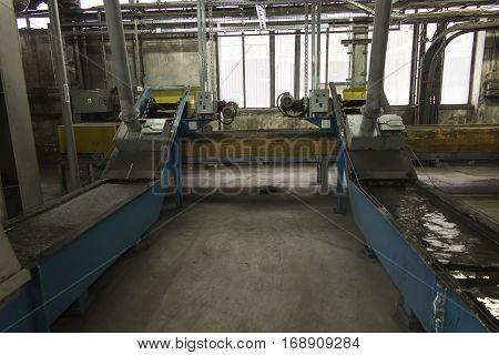 two conveyors scraper slag into a large boiler grate