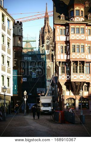 FRANKFURT, GERMANY - JANUARY 05: A narrow alley with a view of the Frankfurt Dome between the historic buildings of the Roman Mountain on January 05, 2017 in Frankfurt.