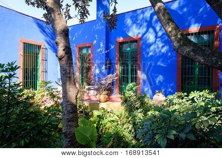 MEXICO CITY,MEXICO - DECEMBER 24,2016 : Colorful courtyard at the Frida Kahlo Museum known as the Blue House  at Coyoacan in Mexico City
