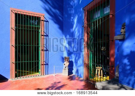 MEXICO CITY,MEXICO - DECEMBER 24,2016 : Courtyard with prehispanic sculptures at the Frida Kahlo Museum at Coyoacan in Mexico City