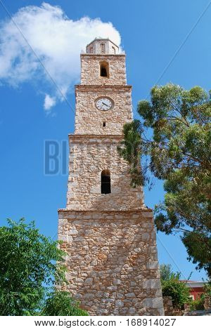 The old stone clock tower at Emborio on the Greek island of Halki. Broken for many years, the clock is always at twenty past four.