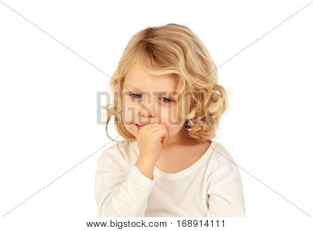Small blond child biting his nails isolated ona  white background