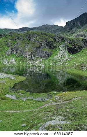 small lake in palasinaz mountains in italy