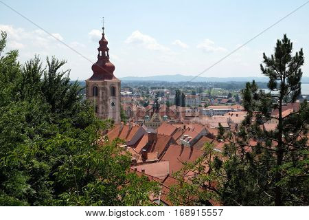 PTUJ, SLOVENIA - JULY 02: Roofs of old city center and Saint George church in Ptuj, town on the Drava River banks, Lower Styria Region, Slovenia on July 02, 2016.