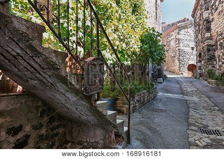 The old staircase with a mailbox hanging on the railing in the picturesque village of Mirabel in the Ardèche region of France..
