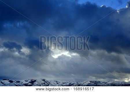 Mountains with stormy sky during winter freezing
