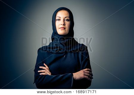 studio shot of young woman wearing traditional arabic clothing