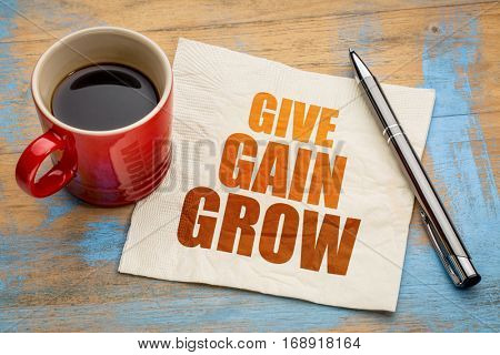 give, gain and grow word abstract -personal development concept on a napkin with a cup of coffee