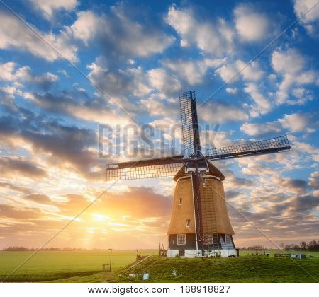 Beautiful Old Dutch Windmill Against Colorful Sky
