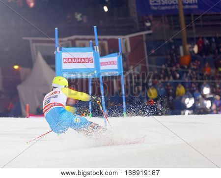 STOCKHOLM SWEDEN - JAN 31 2017: Rear view of Mattias Hargin (SWE) jumping in the downhill skiing in the parallel slalom alpine event Audi FIS Ski World Cup. January 31 2017 Stockholm Sweden