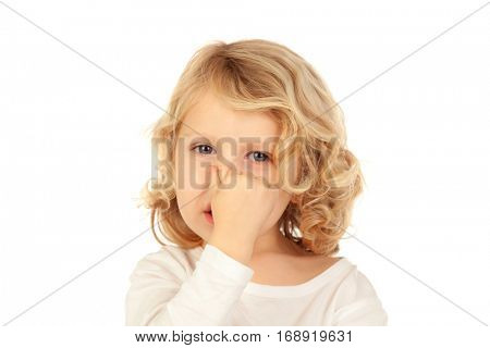 Small child covering his nose isolated on a white background