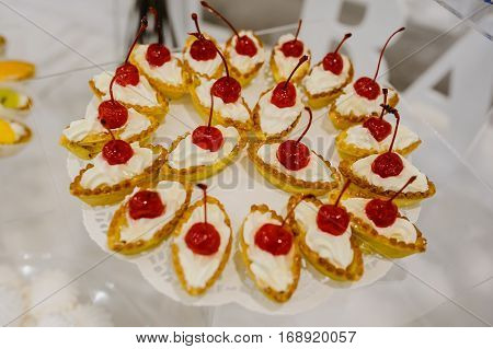 Cakes Basket Boats With Cream And Cherry