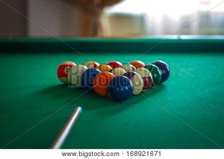 Billiard Balls On Green Table With Billiard Cue In A Hotel Hall