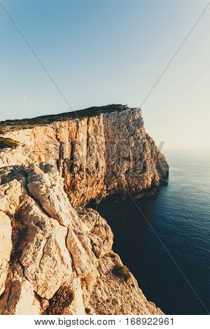 high cliffs and sea, Neptune Grotto in Sardinia, Italy