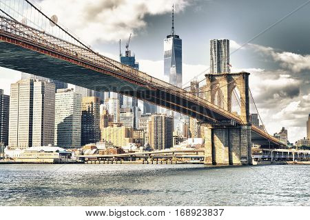 Manhattan skyline with Brooklyn Bridge - HDR image.