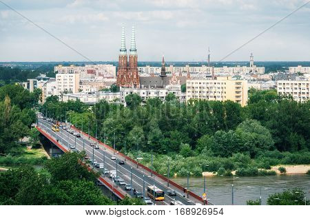 Aerial view of cityscape of Warsaw Slasko-Dabrowski bridge over the the Vistula river on the foreground and Cathedral of St. Michael the Archangel and St. Florian the Martyr among the buildings of Praga district on the background. Poland