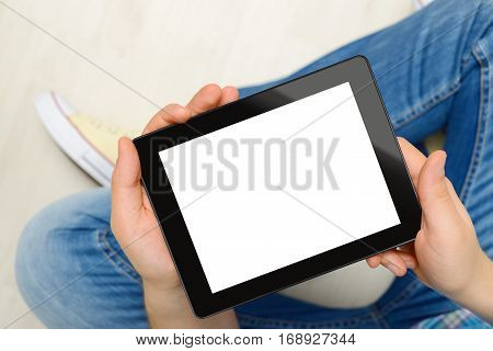 Men holding black touch screen tablet computer with blank screen