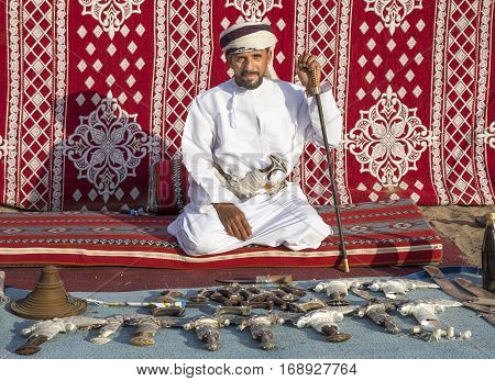 Muscat Oman February 4th 2017: omani man selling traditional khanjar daggers