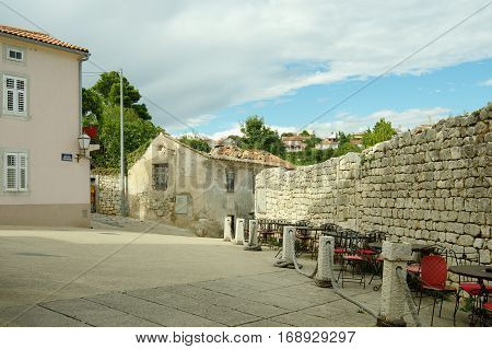 Krk Croatia: a town in the south of the island of Krk. It is a tourist resort in old town there are preserved fragments of buildings from Roman times. Defensive walls of the Frankopanski Castle and old building.