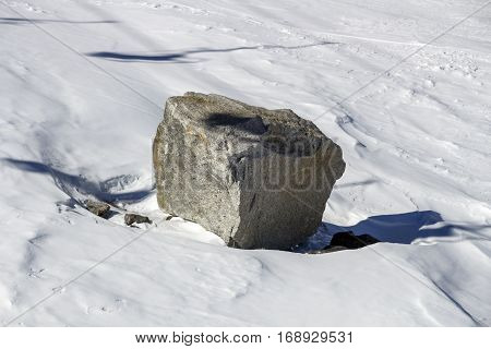 Large rock offside the piste in the ski region of the Hintertuxer Glacier (Tuxer Ferner) in Tyrol Austria
