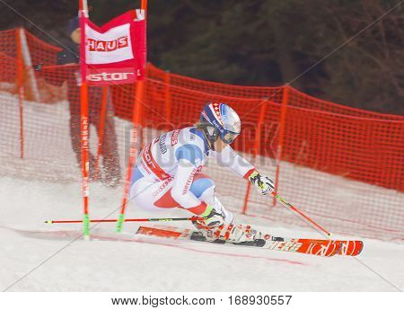 STOCKHOLM SWEDEN - JAN 31 2017: Rear view of Melanie Meillard (SUI) in the downhill skiing in the parallel slalom alpine event Audi FIS Ski World Cup. January 31 2017 Stockholm Sweden