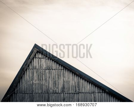 Minimalist Image Of An Industrial Sloping Factory Roof With Copy Space