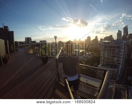 Man taking a selfie with Sydney Skyline on background, Australia