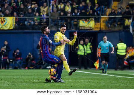 VILLARREAL, SPAIN - JANUARY 8: (L) Pique and Soriano during La Liga soccer match between Villarreal CF and FC Barcelona at Estadio de la Ceramica on January 8, 2016 in Villarreal, Spain
