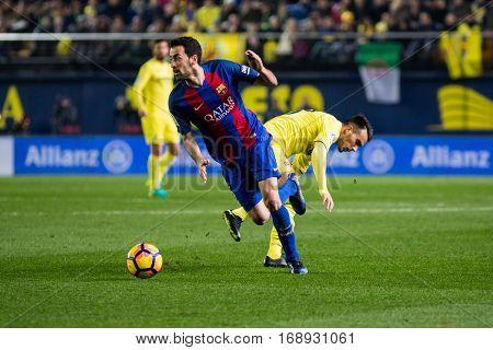 VILLARREAL, SPAIN - JANUARY 8: Sergio Busquets with ball during La Liga soccer match between Villarreal CF and FC Barcelona at Estadio de la Ceramica on January 8, 2016 in Villarreal, Spain