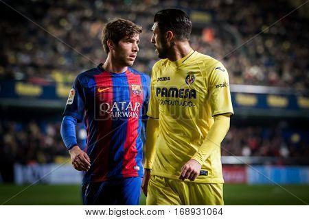 VILLARREAL, SPAIN - JANUARY 8: (L) Sergio Roberto and Soriano during La Liga soccer match between Villarreal CF and FC Barcelona at Estadio de la Ceramica on January 8, 2016 in Villarreal, Spain