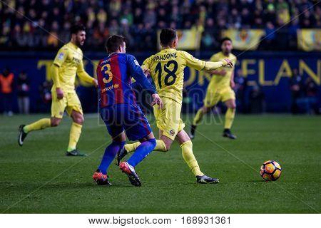 VILLARREAL, SPAIN - JANUARY 8: 18 Sansone, 3 Pique during La Liga soccer match between Villarreal CF and FC Barcelona at Estadio de la Ceramica on January 8, 2016 in Villarreal, Spain