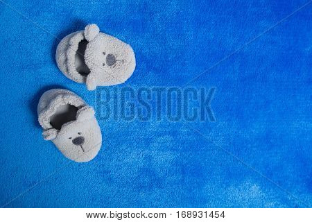 Grey booties on the blue material with copy space